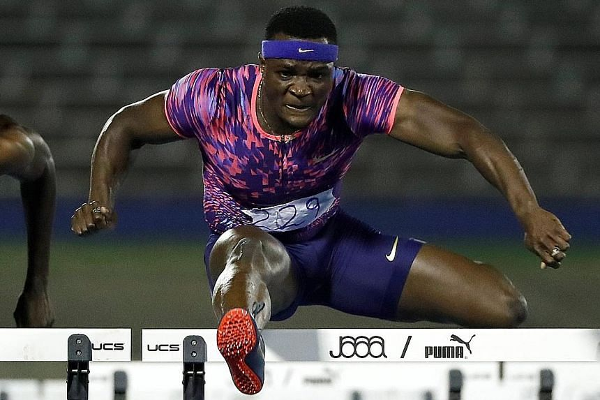 Omar McLeod attacking a hurdle at the Jamaica championships. The 23-year-old has a new-found passion for the sport.