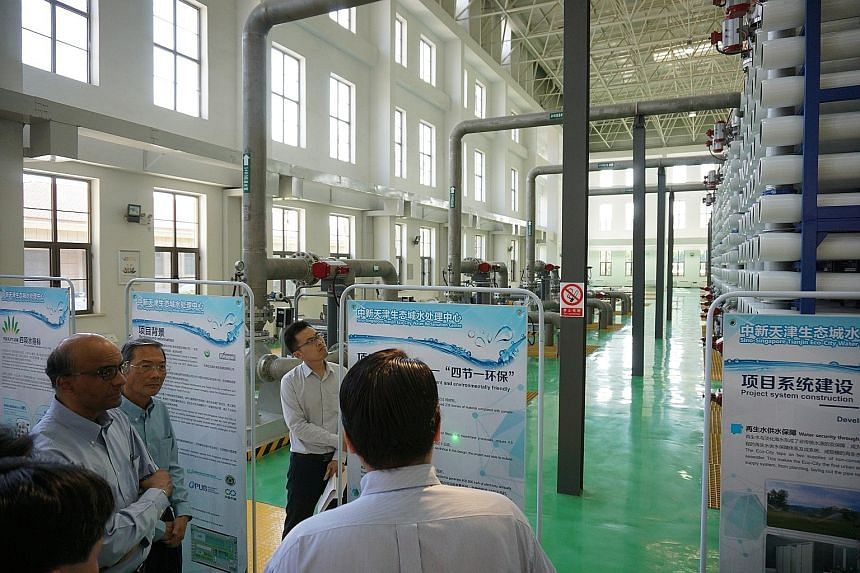 Deputy Prime Minister Tharman Shanmugaratnam and Keppel Corporation chairman Lee Boon Yang at the new water reclamation centre in Tianjin Eco-City yesterday. The new facility, which can treat 100,000 cubic m of wastewater and produce 21,000 cubic m o
