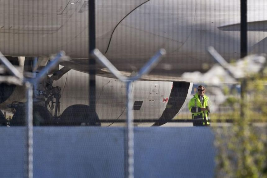 It was the second scare involving an Airbus A330 in Australia this month, with a China Eastern plane (above) making an emergency landing in Sydney after a huge hole appeared in one of its engine casings.