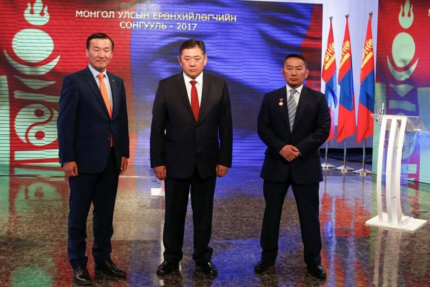 Candidates in the presidential election Sainkhuu Ganbaatar of Mongolian People's Revolutionary Party (MPRP), (from left) Mieygombo Enkhbold of Mongolian People's Party (MPP), and Khaltmaa Battulga of the Democratic Party before a televised debate in