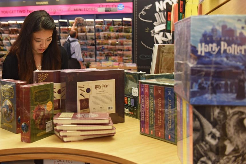 A customer browsing the Harry Potter display at Books Kinokuniya, set up to mark the 20th anniversary of the publication of Harry Potter And The Philosopher's Stone.