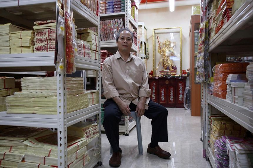 William Lee, proprietor of a joss paper store at Loyang Point Shopping Complex.