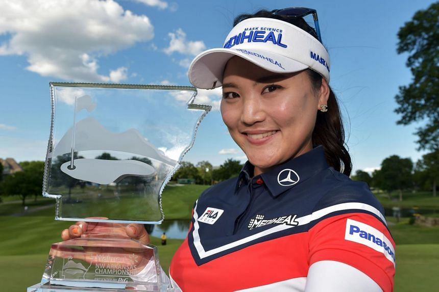 So Yeon Ryu displaying the trophy after winning the Walmart NW Arkansas Championship Presented by P&G at the Pinnacle Country Club in Rogers, Arkansas, on June 25, 2017.