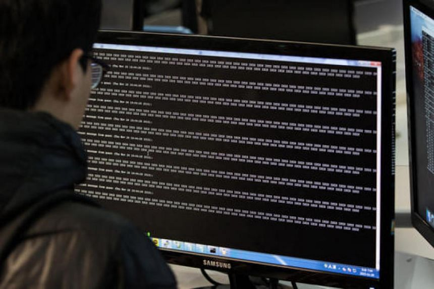 """A cyber-defence class in the """"War Room"""" at Korea University in Seoul, where dozens of South Korea's brightest college students practise hacking each other as part of a government scheme to train them to battle some of the world's best hackers."""