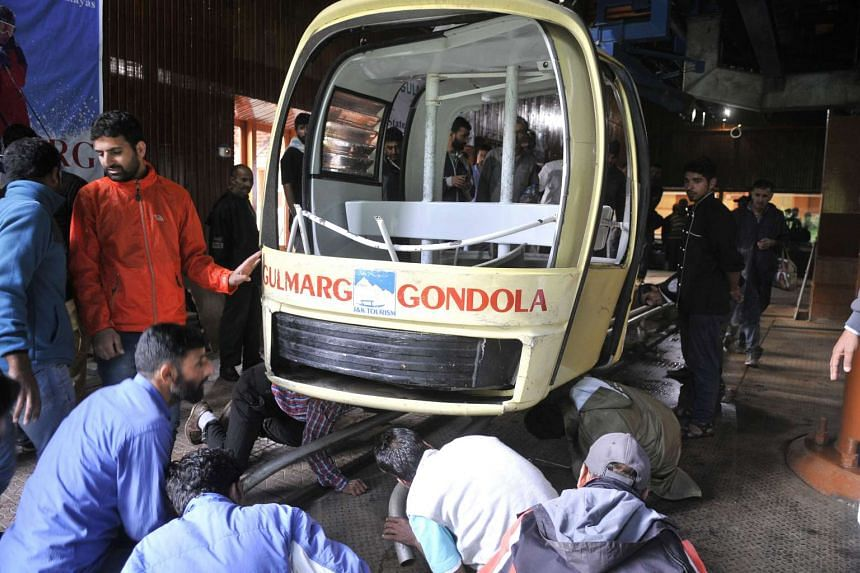 People inspect a section of the cable car which collapsed at Gulmarg on June 25, 2017.