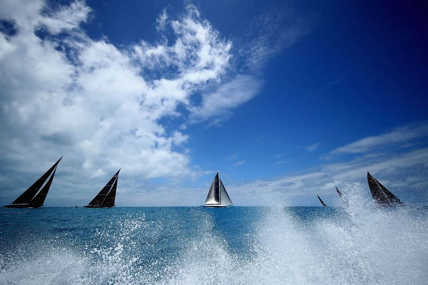 Yachts tack and cruise during the America's Cup in Hamilton, Bermuda.