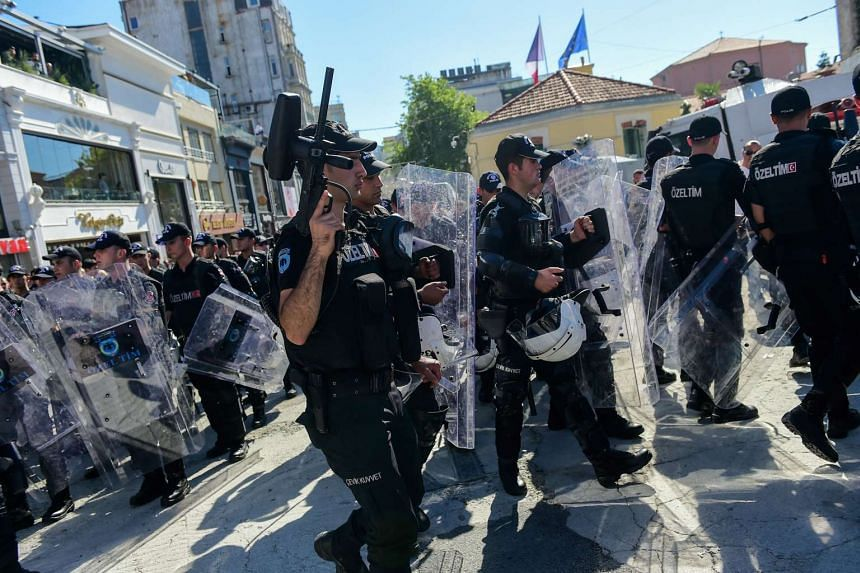 Turkish riot police officers block ways to Istikjlal avenue for LGBT rights activist as they try to gather for a pride parade on June 25, 2017