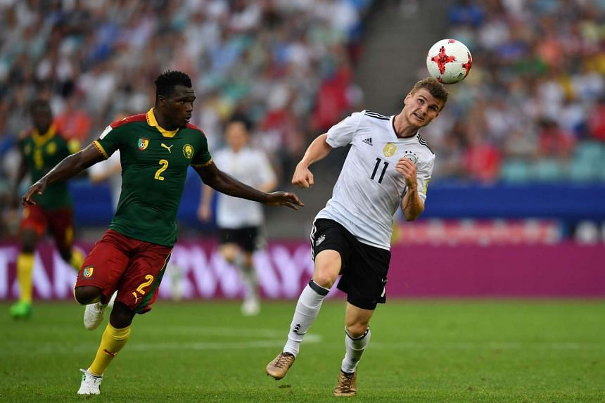 Germany's forward Timo Werner (right) challenges Cameroon's defender Ernest Mabouka in Sochi on June 25, 2017.