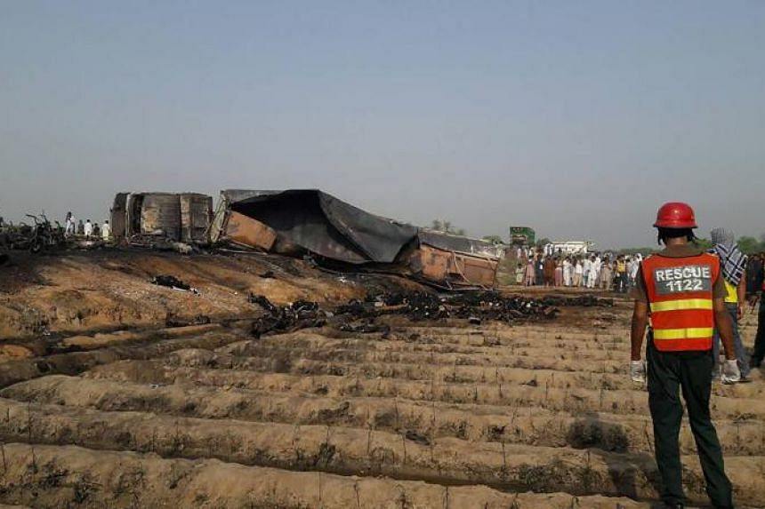 At least 150 people were killed and scores injured in a fire that broke out after a fuel tanker overturned in Pakistan early on Sunday (June 25).