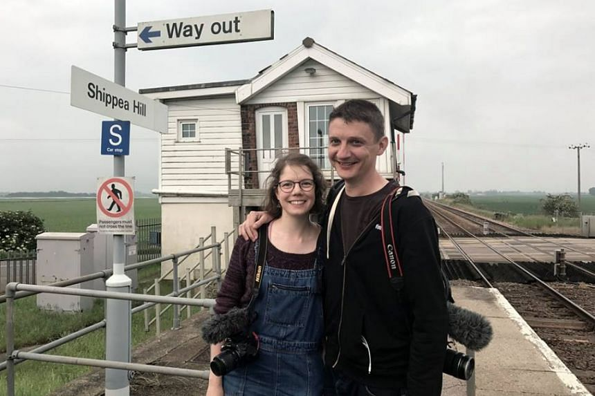 Vicki Pipe (left) and Geoff Marshall are more than halfway through their trip across Britain, where they aim to visit all 2,563 of the country's railway stations. PHOTO: ALL THE STATIONS / FACEBOOK