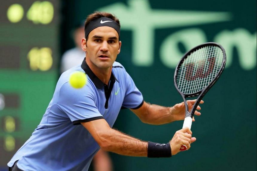 Roger Federer of Switzerland in action against Alexander Zverev of Germany during their final match of the ATP tennis tournament in Halle, Germany, on June 25, 2017.