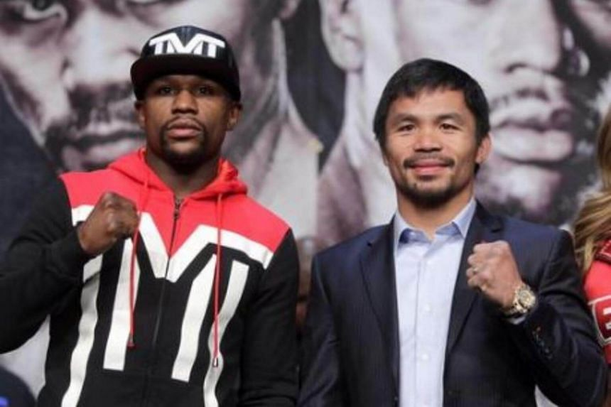 Manny Pacquiao's (right) trainer said the boxer may go for a rematch with Floyd Mayweather if he wins his bout this weekend.