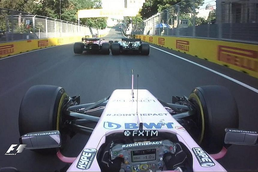 Vettel speeds up till he is alongside Hamilton, raises his fist in protest and swerves into the Mercedes.
