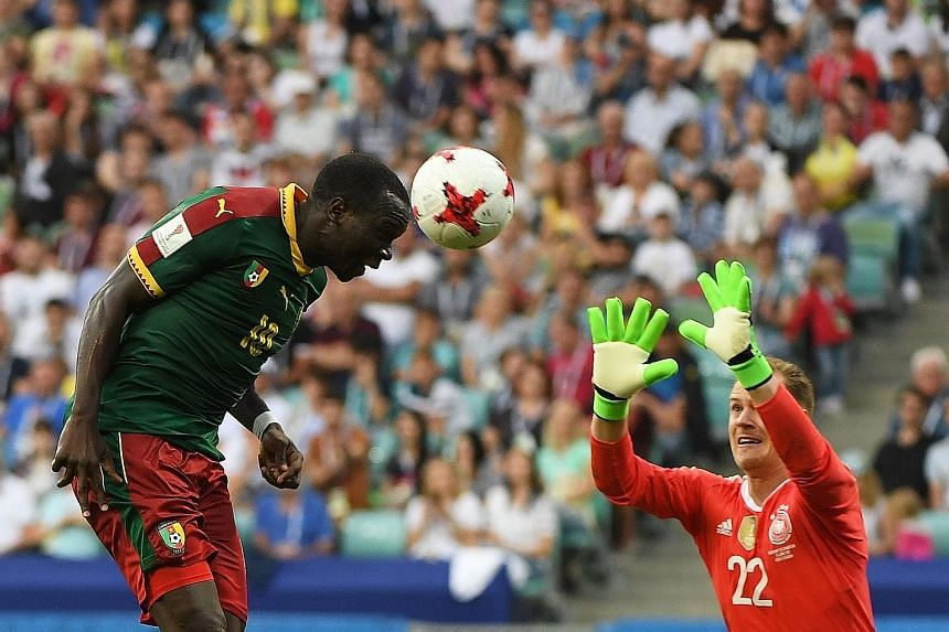 Cameroon forward Vincent Aboubakar scoring his country's consolation goal against world champions Germany. Joachim Low's side will face Mexico in the Confederations Cup semi-final on Thursday.