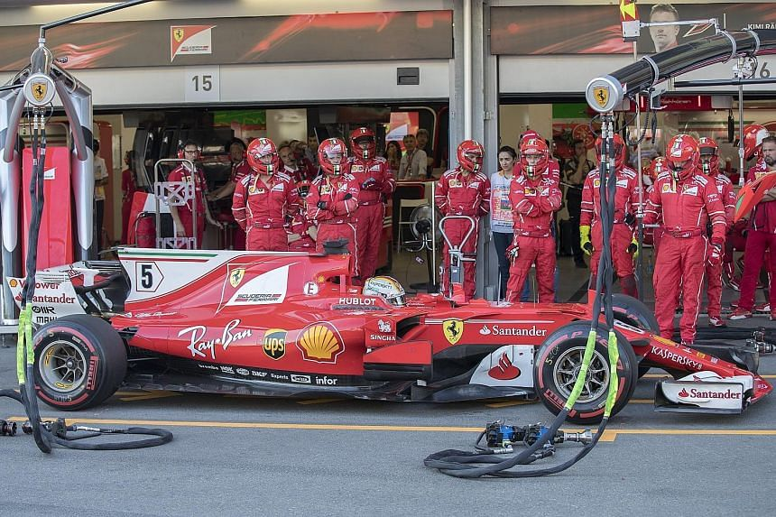 Vettel waiting out a 10-second stop-go penalty for dangerous driving at the Azerbaijan Grand Prix.
