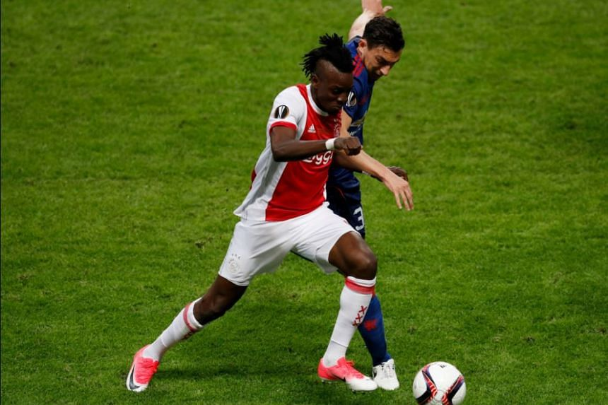 Ajax's Bertrand Traore in action with Manchester United's Matteo Darmian