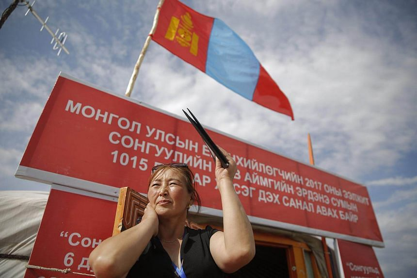 A Mongolian election official waiting for voters during Mongolia's presidential elections at a polling station in Erdensom County, Tuv Province, on June 26, 2017.