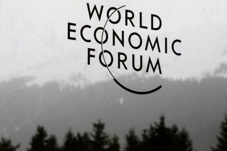 A logo of the World Economic Forum (WEF) sticks on a window at the congress centre in the Swiss mountain resort of Davos.