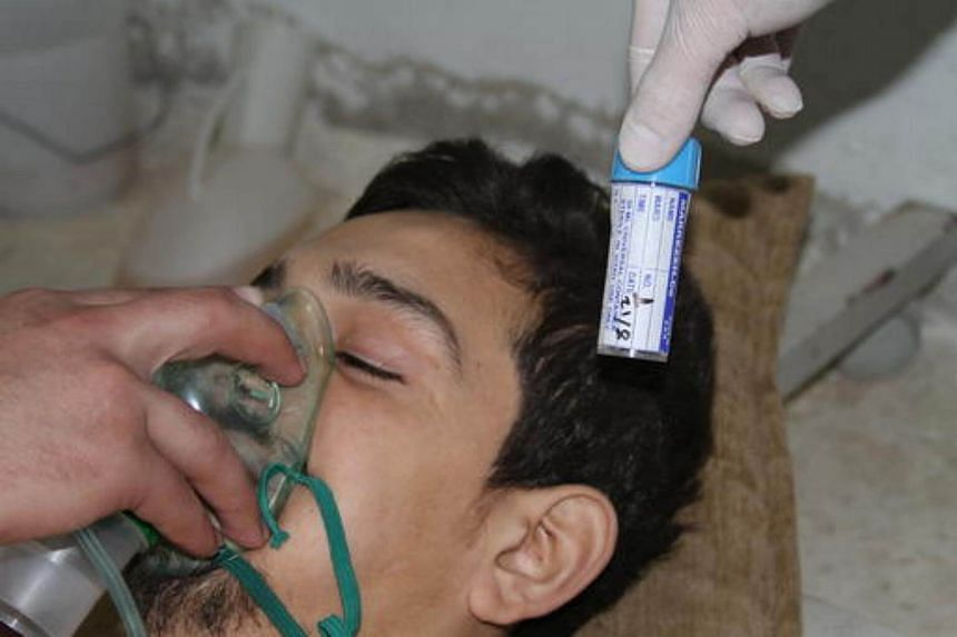 A young man is treated for the effects of chemical poisoning after a suspected chemical weapons attack in the Ghouta suburb of Damascus.