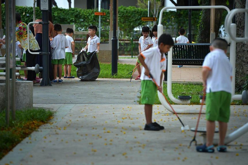 Children from My First Skool kindergarten clearing rubbish at the playground in Toa Payoh Central.