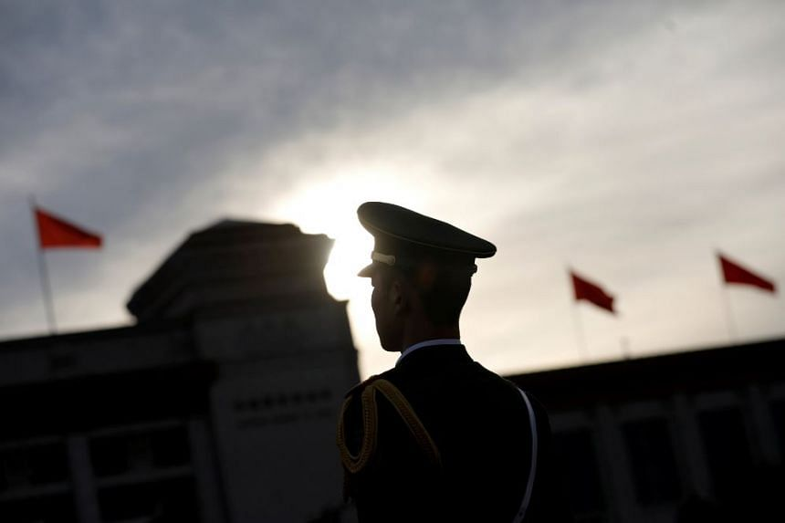 A security personnel stands guard ahead of the opening session of the National People's Congress (NPC) outside the Great Hall of the People in Beijing, China, March 5, 2017.