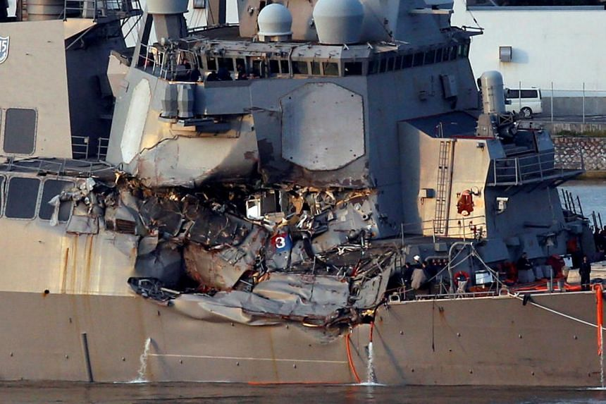 The USS Fitzgerald, damaged by colliding with a Philippine-flagged merchant vessel, is towed into the US naval base in Yokosuka.