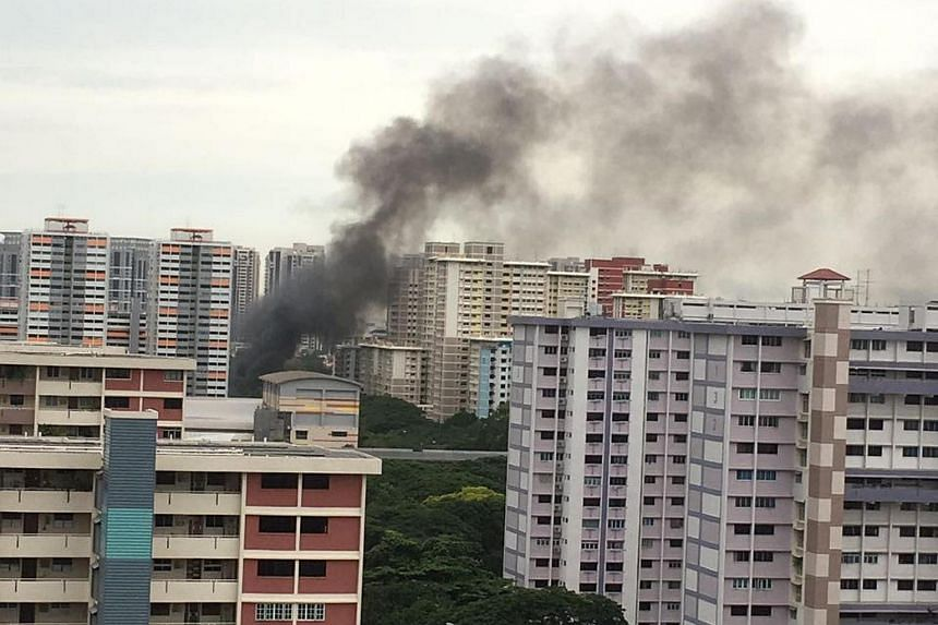 Black smoke was seen rising from a block of flats in Bedok South.