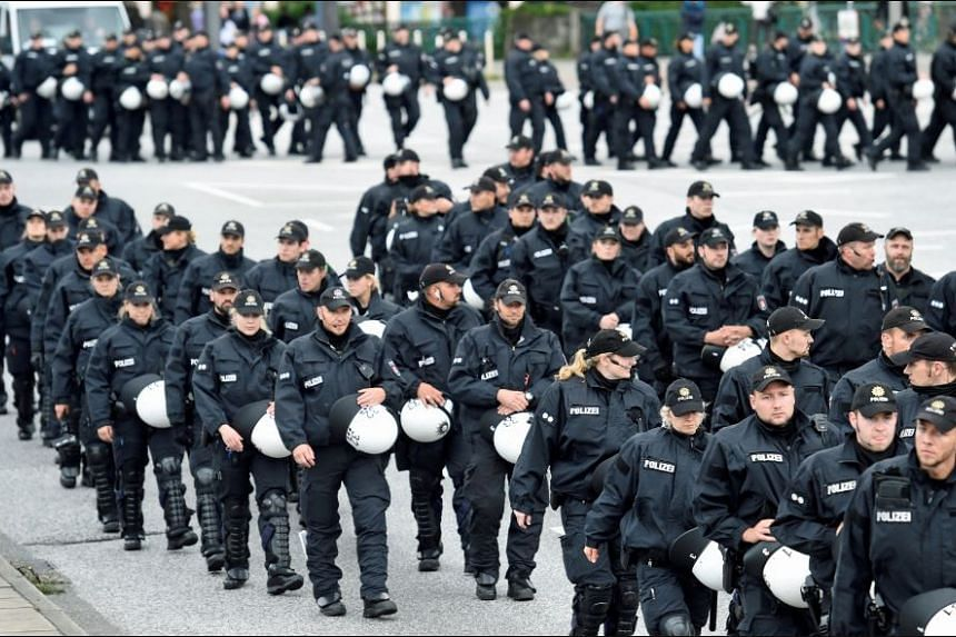 Police forces patrol during a demonstration against a new temporary prison for the G20 Summit in Hamburg, Germany, June 24, 2017.