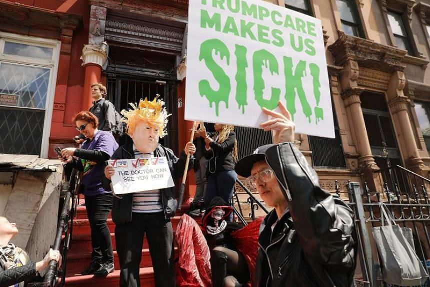 Activists protesting in New York City on May 9 against the passage of the Republican healthcare Bill in the House of Representatives.