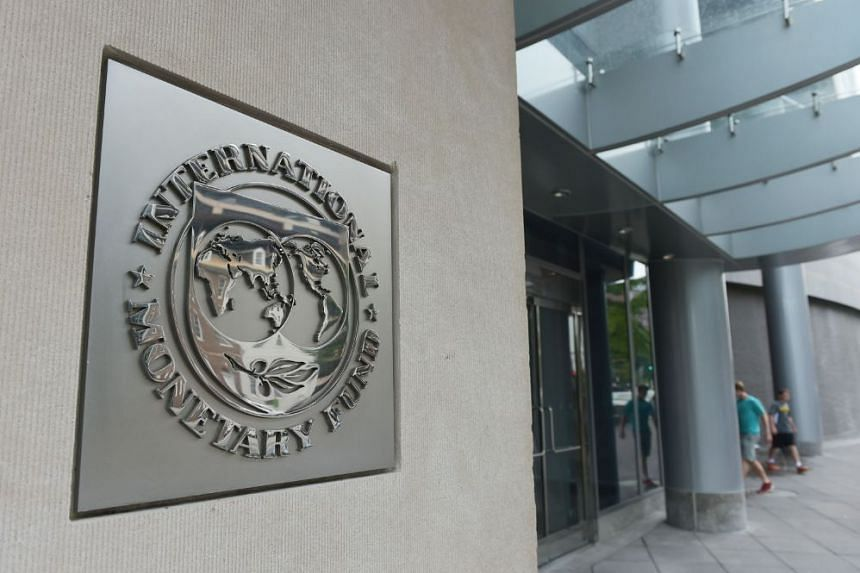 This file photo taken on July 5, 2015 shows the seal of the International Monetary Fund (IMF) at the organization's headquarters in Washington, DC.