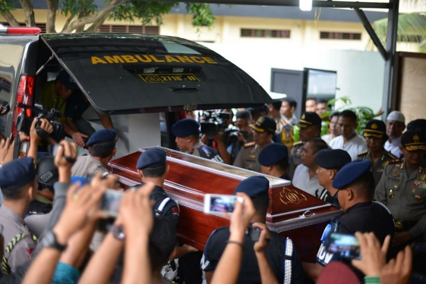 Indonesian police officers carrying the coffin of Aiptu Martua, an officer who was killed in an alleged terrorist attack, in Medan on June 25, 2017.