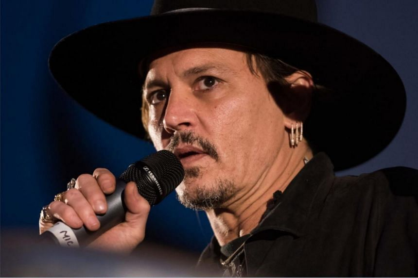 Johnny Depp introducing his film, The Libertine, at the Glastonbury Festival of Music and Performing Arts in Somerset, South West England.