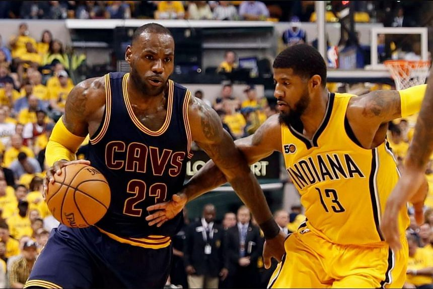 Cleveland Cavaliers forward LeBron James (23) drives to the basket against Indiana Pacers forward Paul George (13) in game three of the first round of the 2017 NBA Playoffs at Bankers Life Fieldhouse.