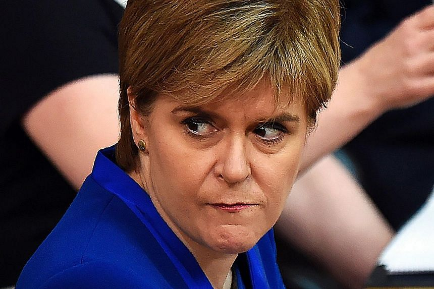 Scotland's First Minister and Scottish National Party (SNP) leader Nicola Sturgeon reacts as she sits in the chamber at the Scottish Parliament in Edinburgh on June 27, 2017.