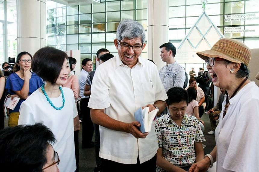 Minister for Communications and Information Yaacob Ibrahim sharing a light moment with NLB chief executive Elaine Ng (left) and visitors.