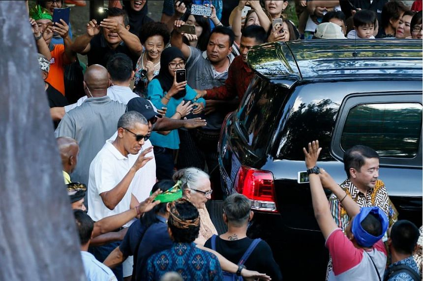 Former US president Barack Obama (bottom left) and his family visit the Tirta Empul Temple during a family holiday in Bali, Indonesia, 27 June 2017.