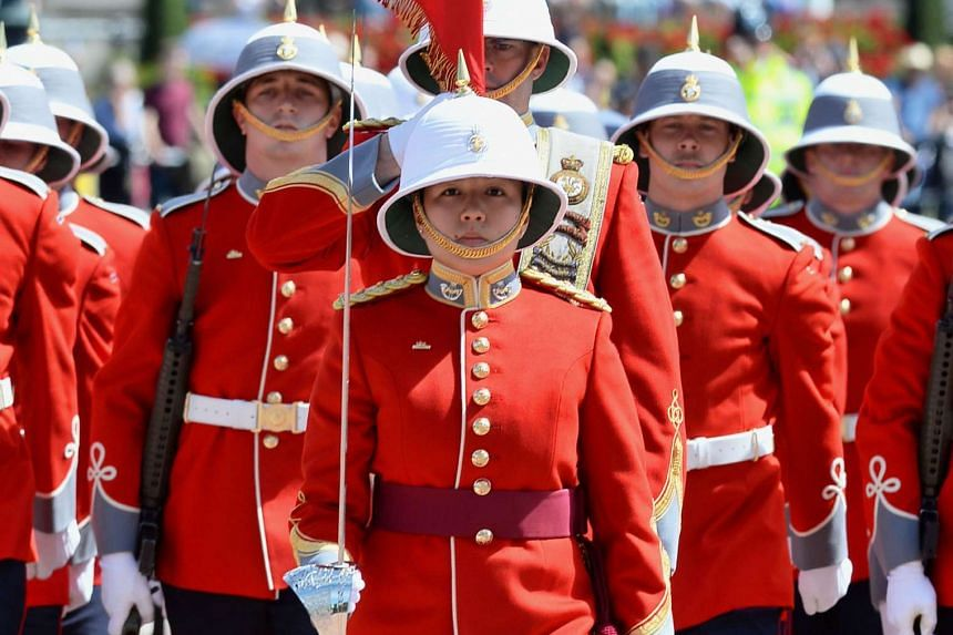 Captain Megan Couto (centre) leads her battalion as the first female infantry officer to command the Queen's Guard on June 26, 2017.