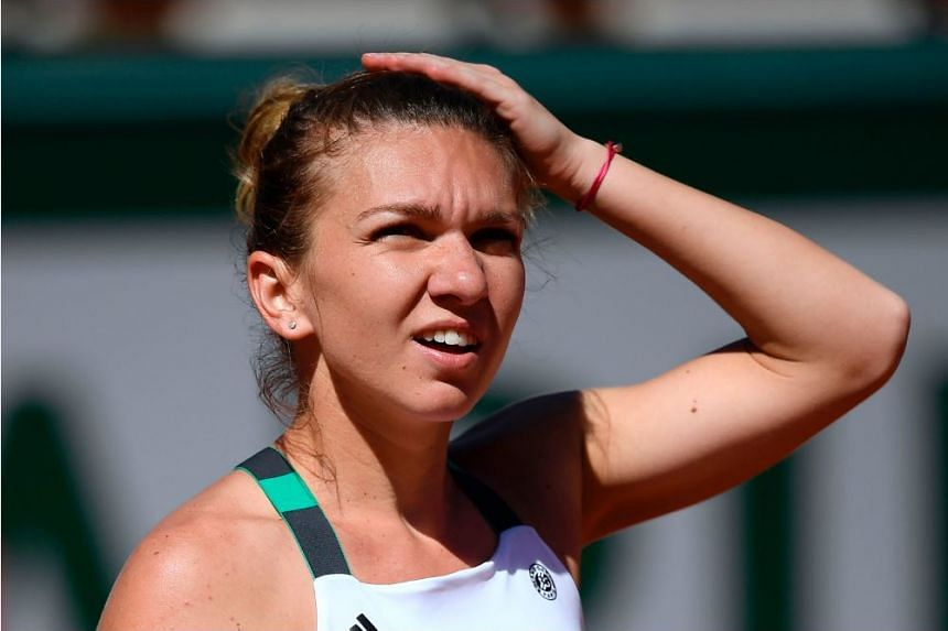 Romania's Simona Halep reacts after a point against Latvia's Jelena Ostapenko during their final tennis match at the Roland Garros 2017 French Open on June 10, 2017 in Paris.
