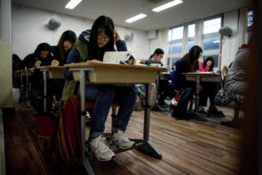 Students sit the annual Scolastic Aptitude Test at a the Poongmun high school in Seoul on Nov 13, 2014.