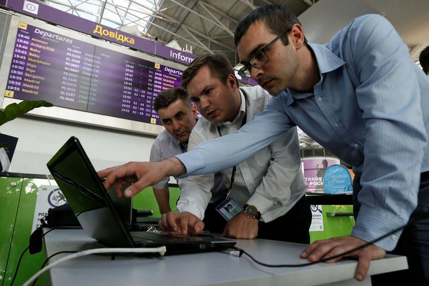 Technicians work at Kiev's Boryspil Airport, which was hit by the ransomware attack.