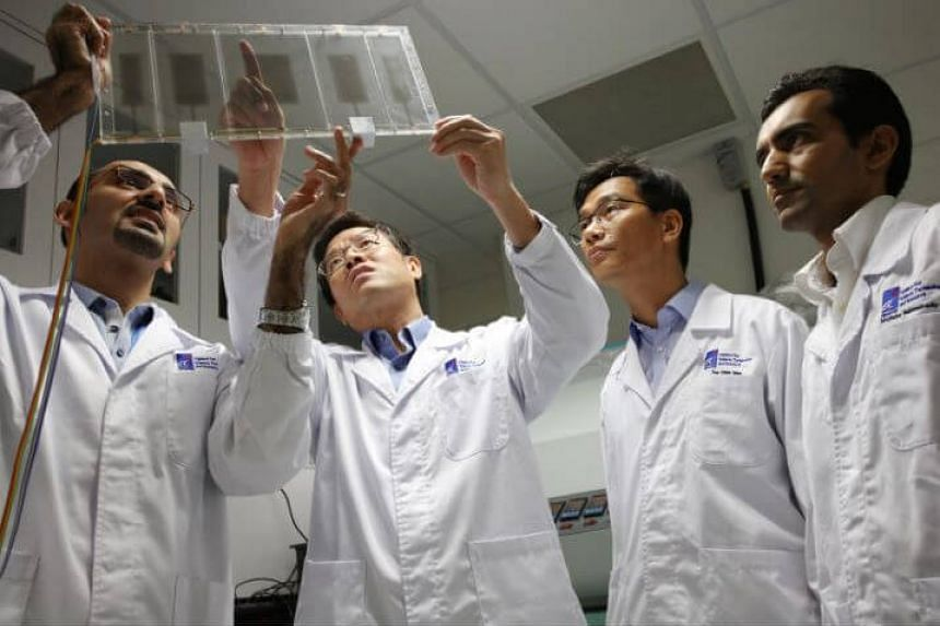 (From left) Meysam Sharifzadeh Mirshekarloo, Dr Yao Kui, Dr Tan Chin Yaw and Mojtaba Rahimabady are the team at A*Star which is currently developing transparent piezoelectric speakers.