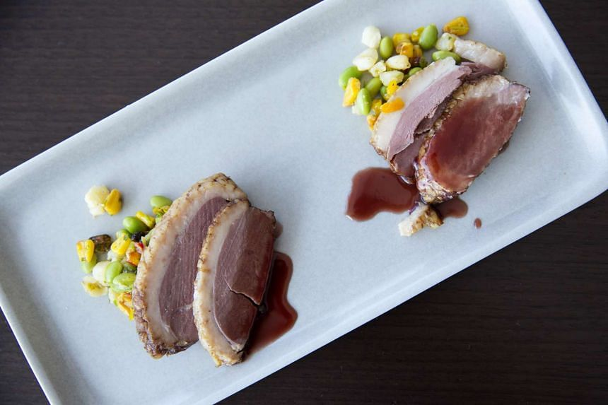 A dish of smoked duck breast with toasted hominy succotash, corn and edamame at American Airlines' Flagship First Dining outlet. PHOTO: BLOOMBERG
