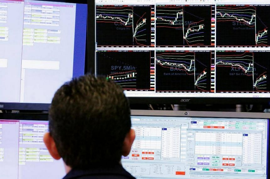 A trader looks at screens while working on the floor of the New York Stock Exchange (NYSE) in New York, US, on March 27, 2017.