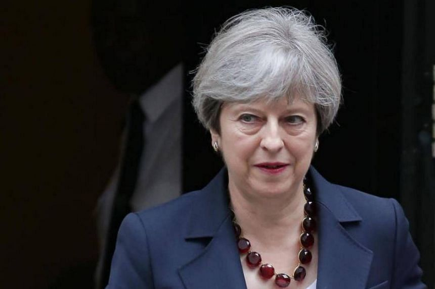 Britain's Prime Minister Theresa May leaves No 10 Downing St on her way to Westminster for Prime Minister's Question Time (PMQs), in central London on June 28, 2017.
