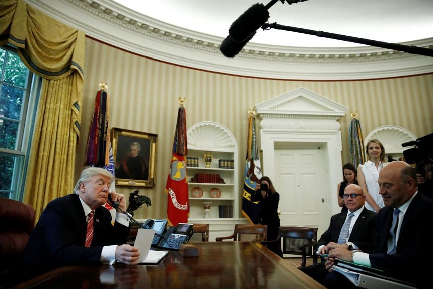 Donald Trump waiting on the line as he calls Prime Minister Leo Varadkar of Ireland to congratulate him for his victory at the Oval Office of the White House in Washington, US on June 27, 2017.