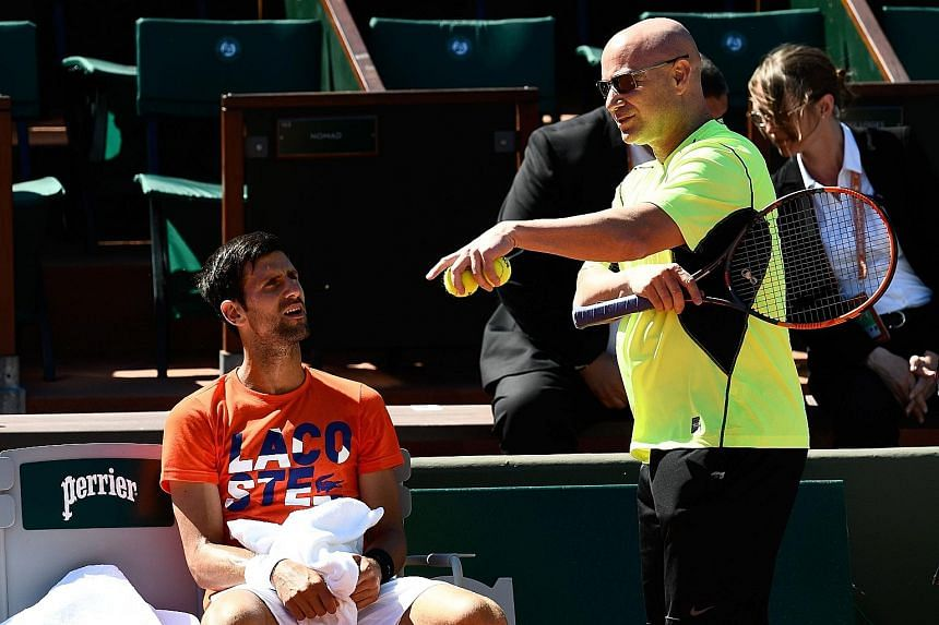 Andre Agassi (right) giving Novak Djokovic feedback at a training session during his short-lived French Open campaign this month. The American will be back to assist the Serb in his attempt to clinch a fourth Wimbledon singles title.