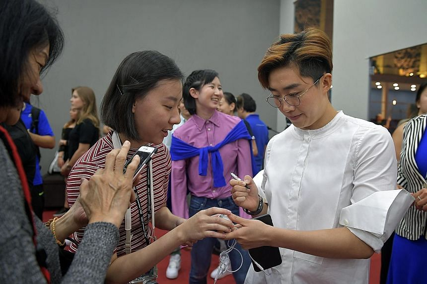 Feng Tianwei signing autographs for fans in Johor Bahru yesterday. The only Singaporean participant said the time-based format will test players' mettle.