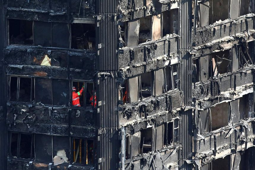 Emergency services workers inside the burnt remains of the Grenfell apartment tower in London last week. Lawyers say that Arconic, the American company that sold the cladding for the building, could face lawsuits on both sides of the Atlantic over it