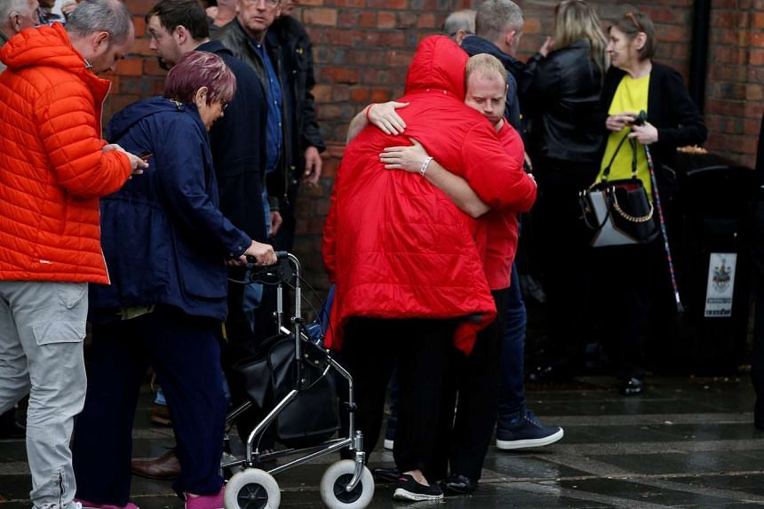Family members of victims of the Hillsborough disaster react outside Parr Hall in Warrington, Britain, on June 28, 2017.  Britain's state prosecution service on Wednesday (June 28) announced criminal charges against six people over the 1989 soccer st