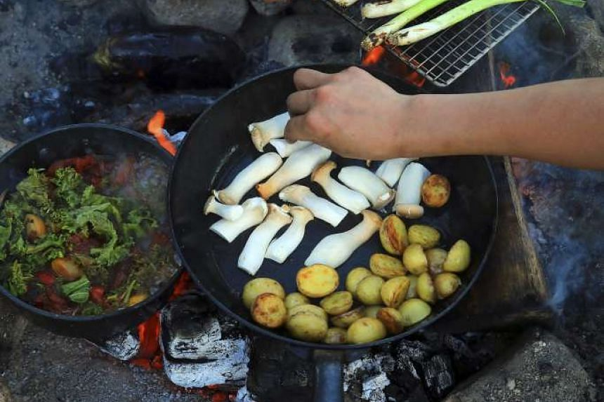 Their menu for backpacking trips is built on resealable silicone bags filled with dried food that they will reconstitute with boiling water from a small stove. PHOTO: NYTIMES